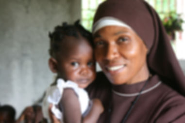 African Sister with tearful child.jpg