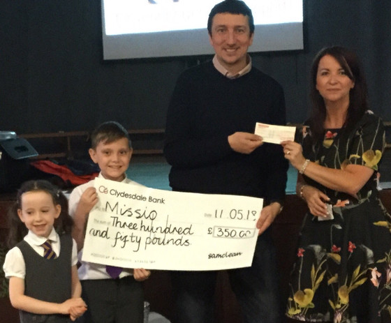 St Aidan's have Missio in cheque