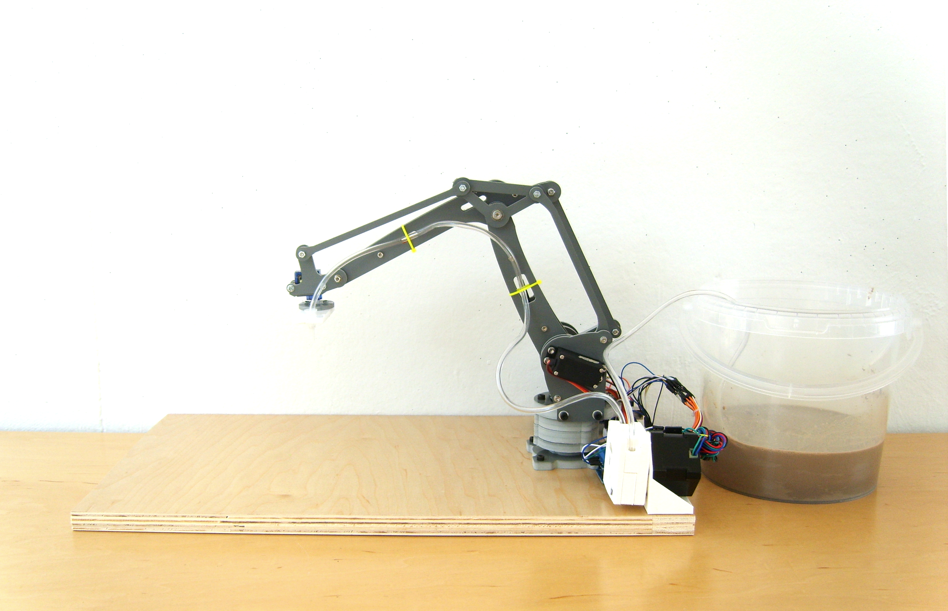 A Robot Arm with a Clay Extruder