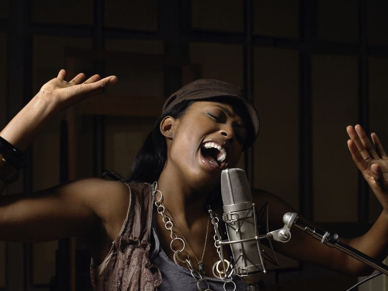 young-woman-singing-74075546-59dd4bcb519