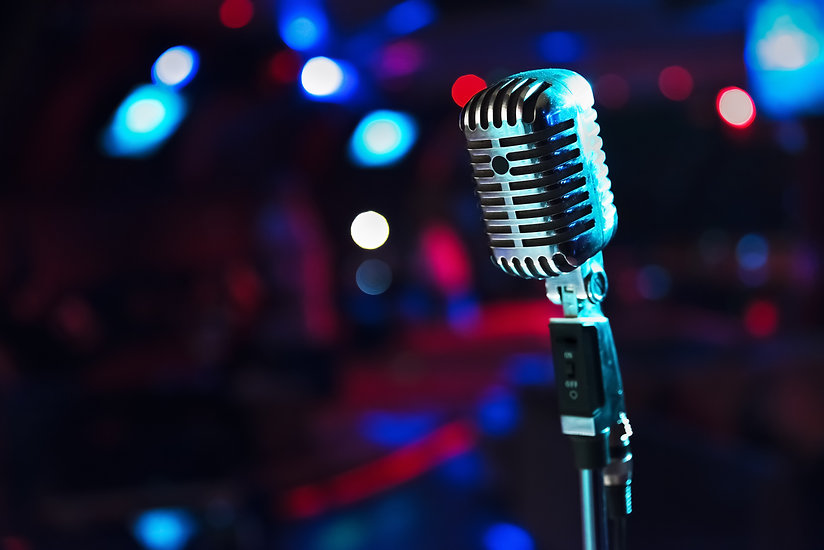 Retro microphone against blur colorful light restaurant background.jpg