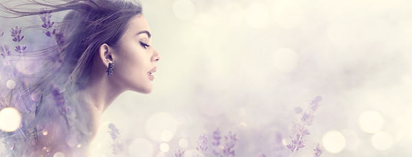 Beauty Model Girl with Lavender flowers