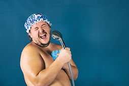Funny fat man in blue cap sing in the sh