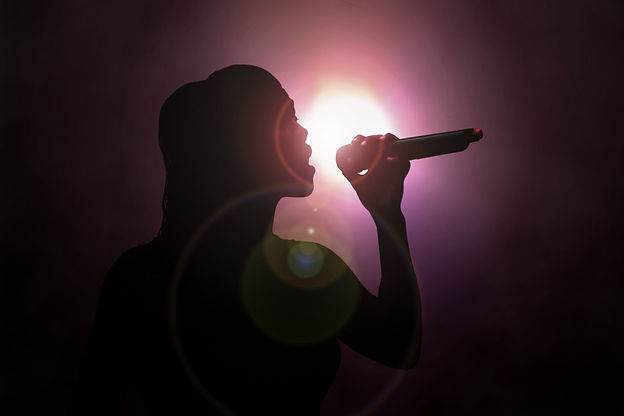 Women singing under spotlight.jpg