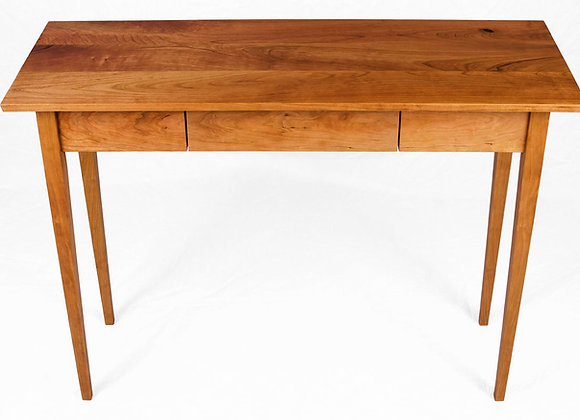 Solid cherry hall table with tapered legs and floating drawer