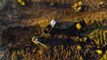 excavator-removes-soil-from-soil-loads-i