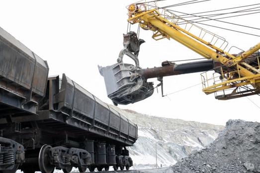 excavator-loads-stones-into-cars_131087-