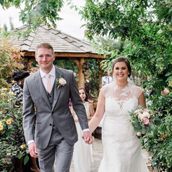 Bride and Groom with with Bouquet and Boutonniere