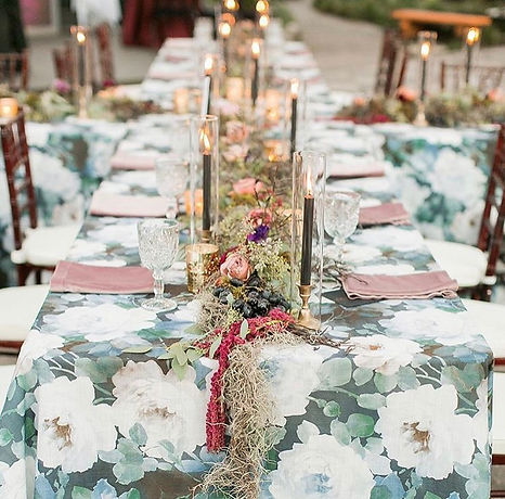 Dark and moody wedding reception with candle stick and black taper tablescape