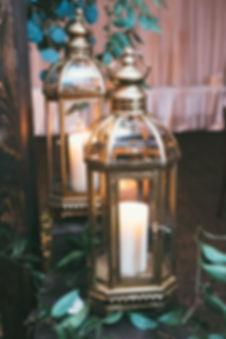 gold lantern decor at wedding reception