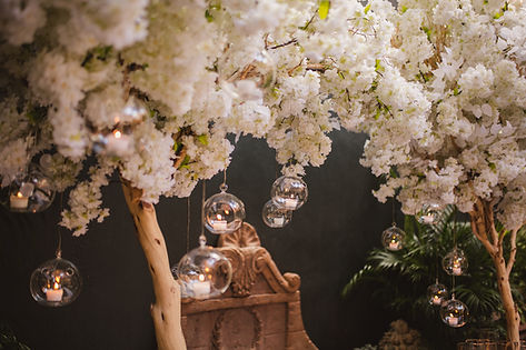 tree backdrop for wedding ceremony with hanging candles