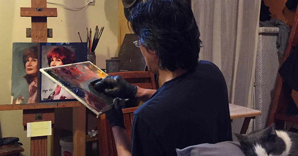 A Commission Portrait Artist Becomes One with Art. Artist painting
