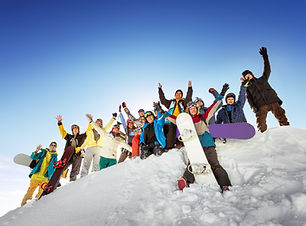 Group of tourists having fun at ski and