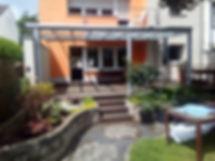 Terrassenüberdachung in Köln mit Glasdach und Belwuchtung. Terrassenüberdachung Wintergarten-Solution Köln