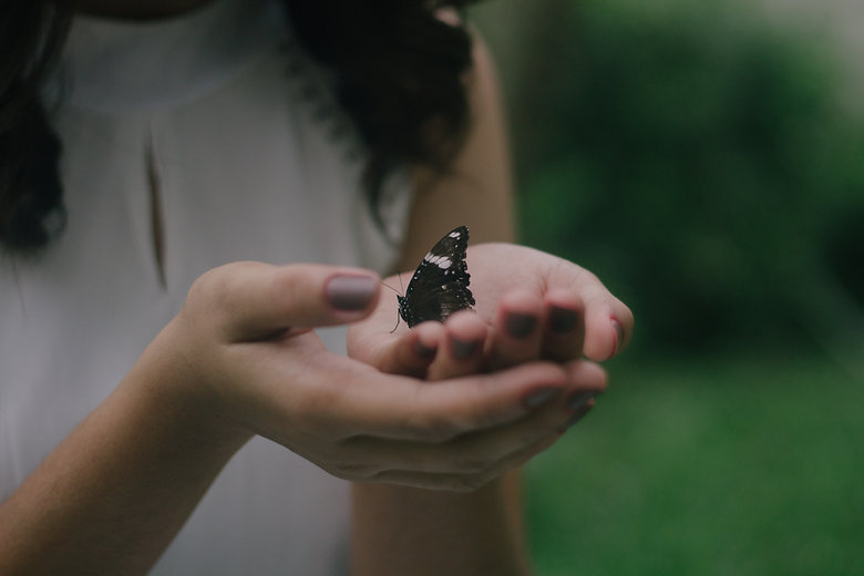 Woman holding butterfly.jpg