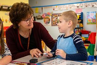 Teacher with Student.JPEG