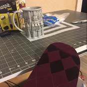 I purchased burgundy tights with a diamond pattern from Amazon and used a Sharpie. Don't do that - use fabric paint!