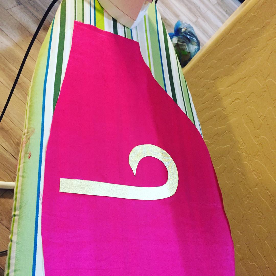 I used Yaya Han's 4 way stretch gold fabric with Heat N Bond