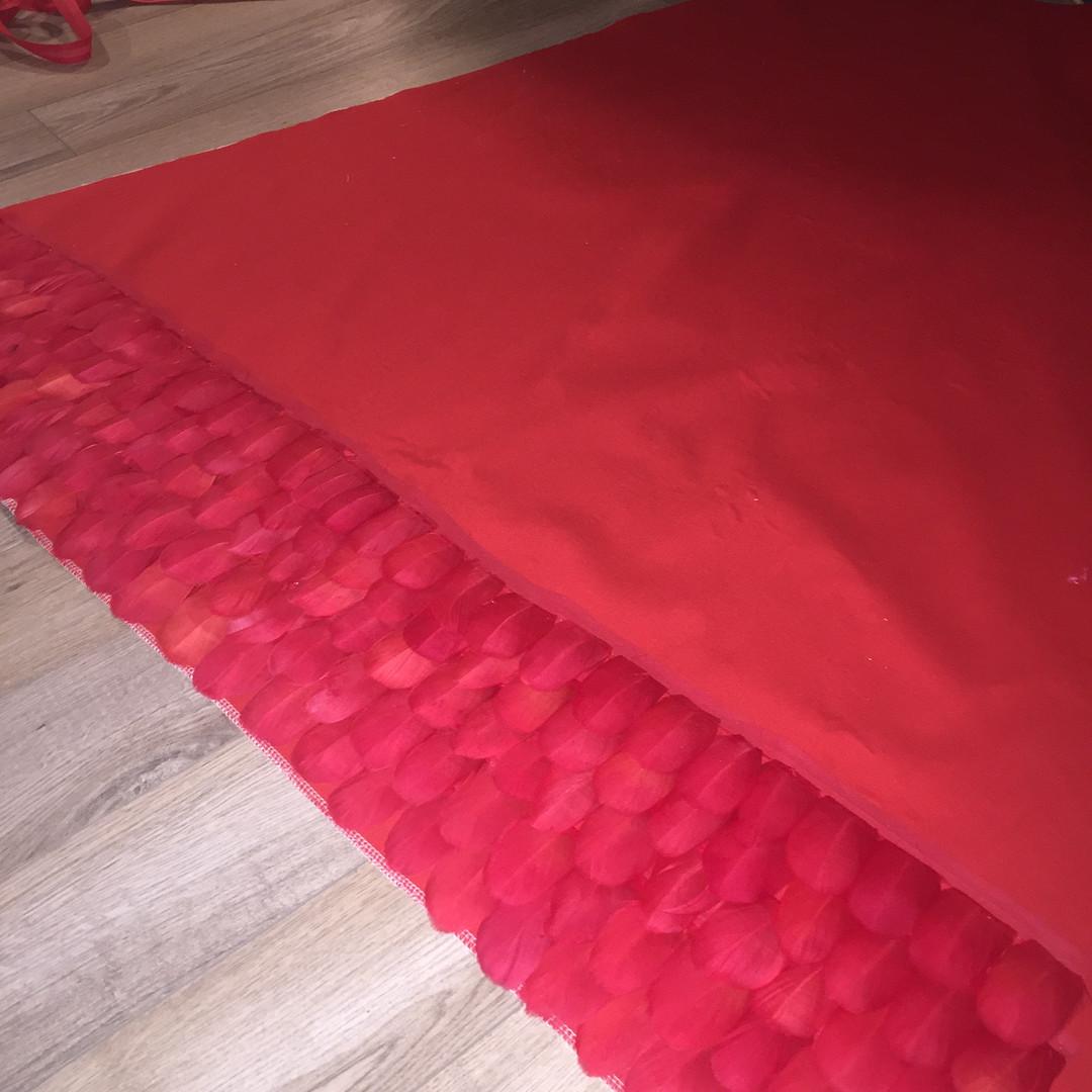 Each row sewn onto the cape.