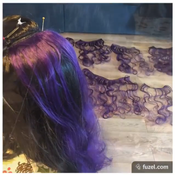 I dismantled the purple wig into wefts and sewed them into the black wig.