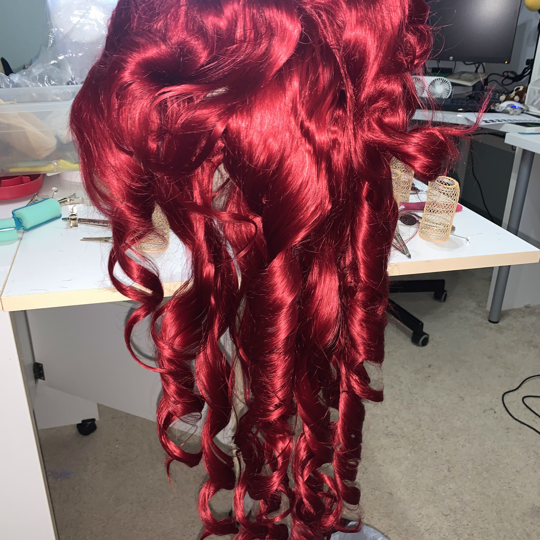 Re-styling the wig with curlers and a steamer