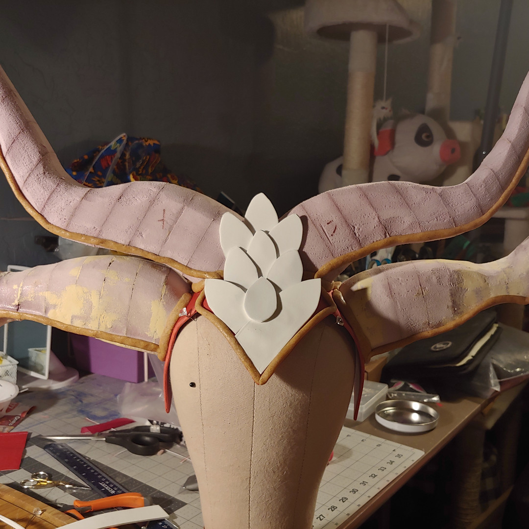 Horns were glued on with hot glue. Scale details are craft foam.
