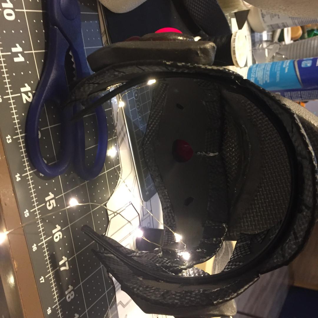 Using a string of lights for her visor.