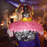 The back of the costume is mostly covered by the wig.