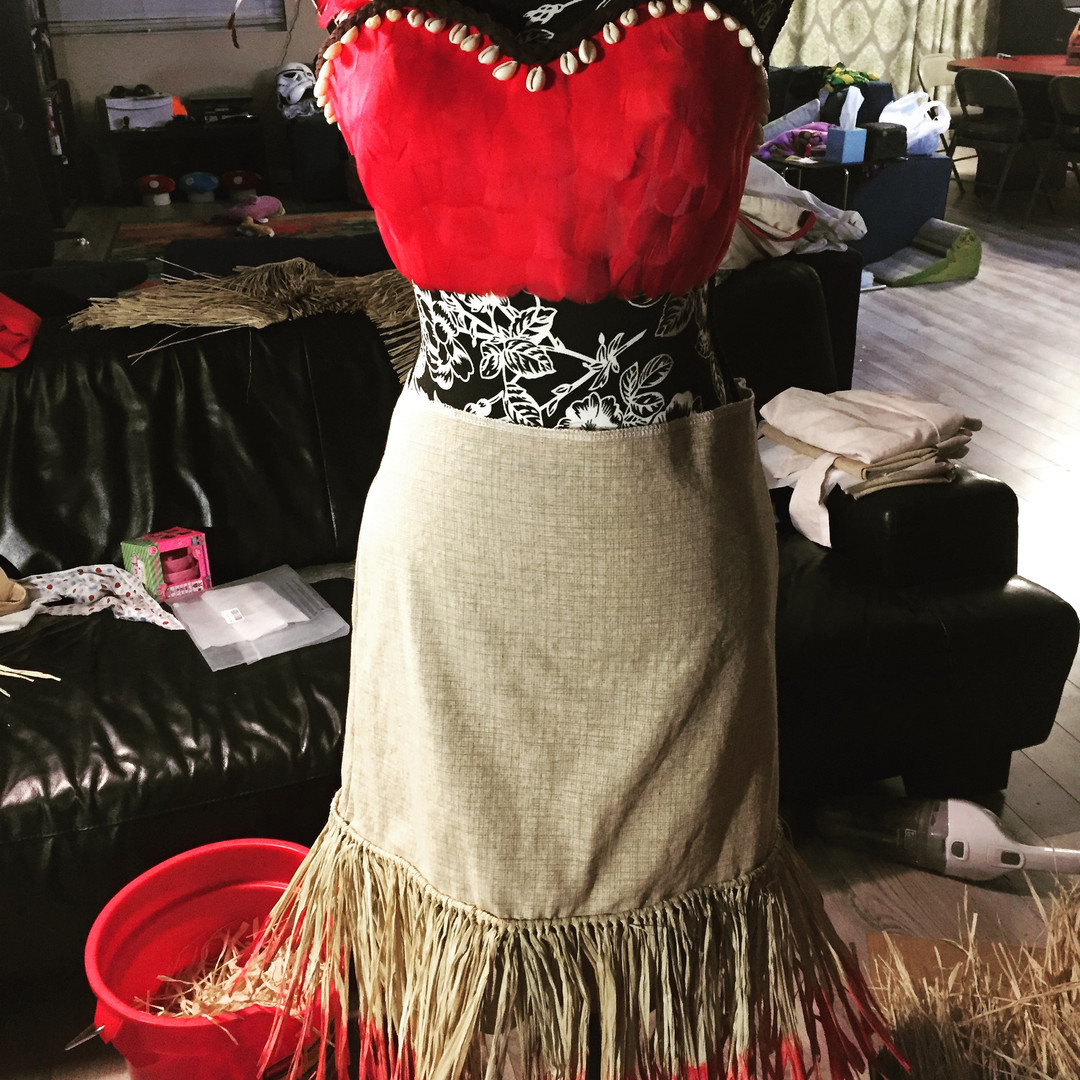 Adding the raffia to the base skirt.