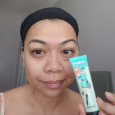 Wig cap on. I start with a clean, moisturized face. Benefit Porefessional goes first.