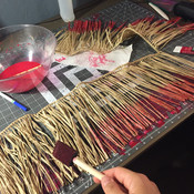Painting the raffia with diluted acrylic.