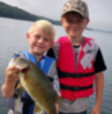 Two young boys who caught a fish at Hillside Resort