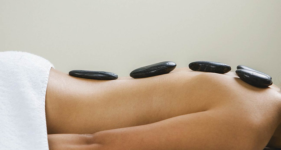 stone_massage_woman-1296x728-header.jpg