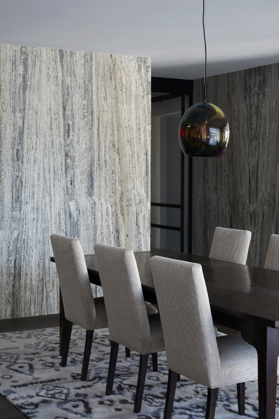 Layers of texture and pattern combine to create a tactile living space.
