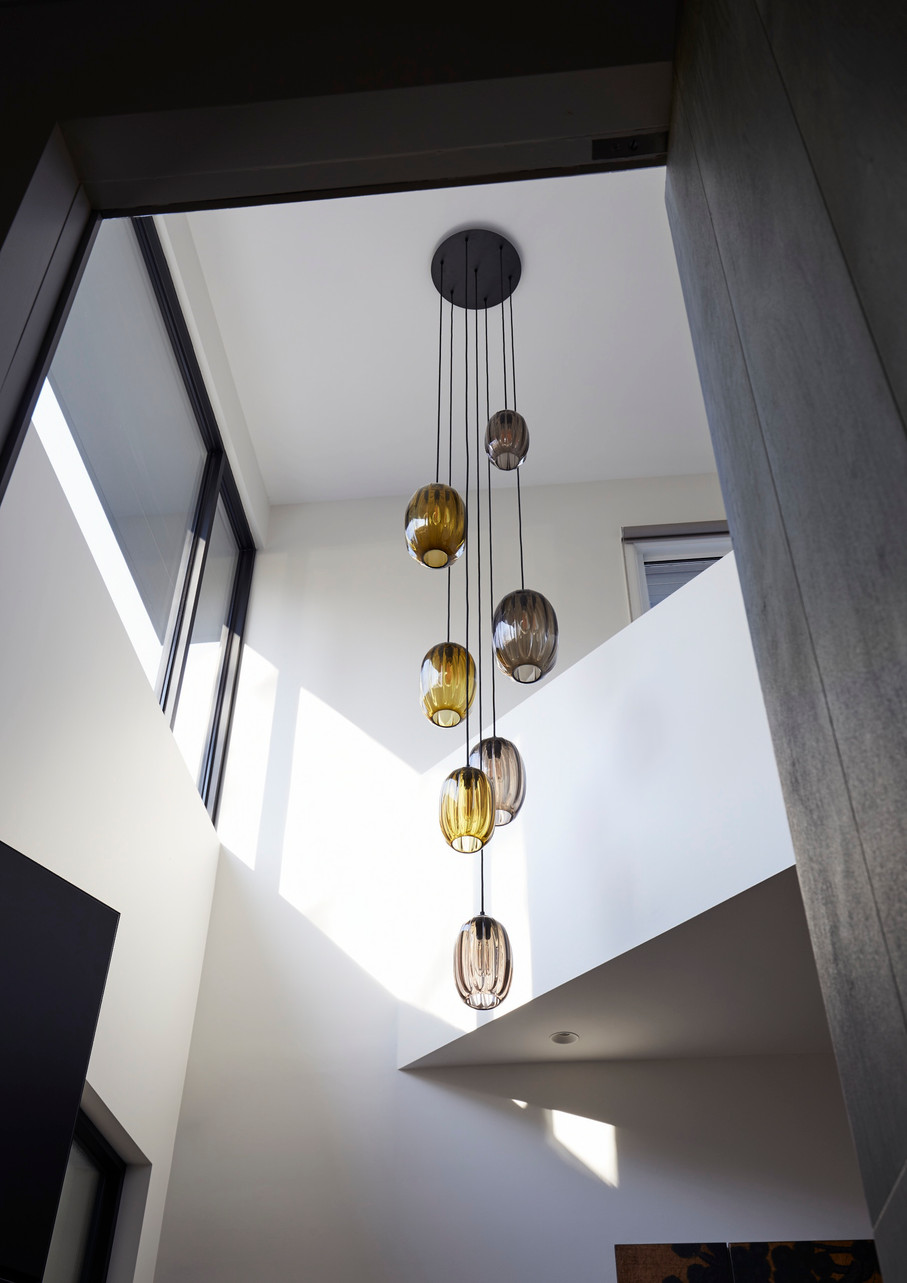 Natural light welcomes in the double height entry void