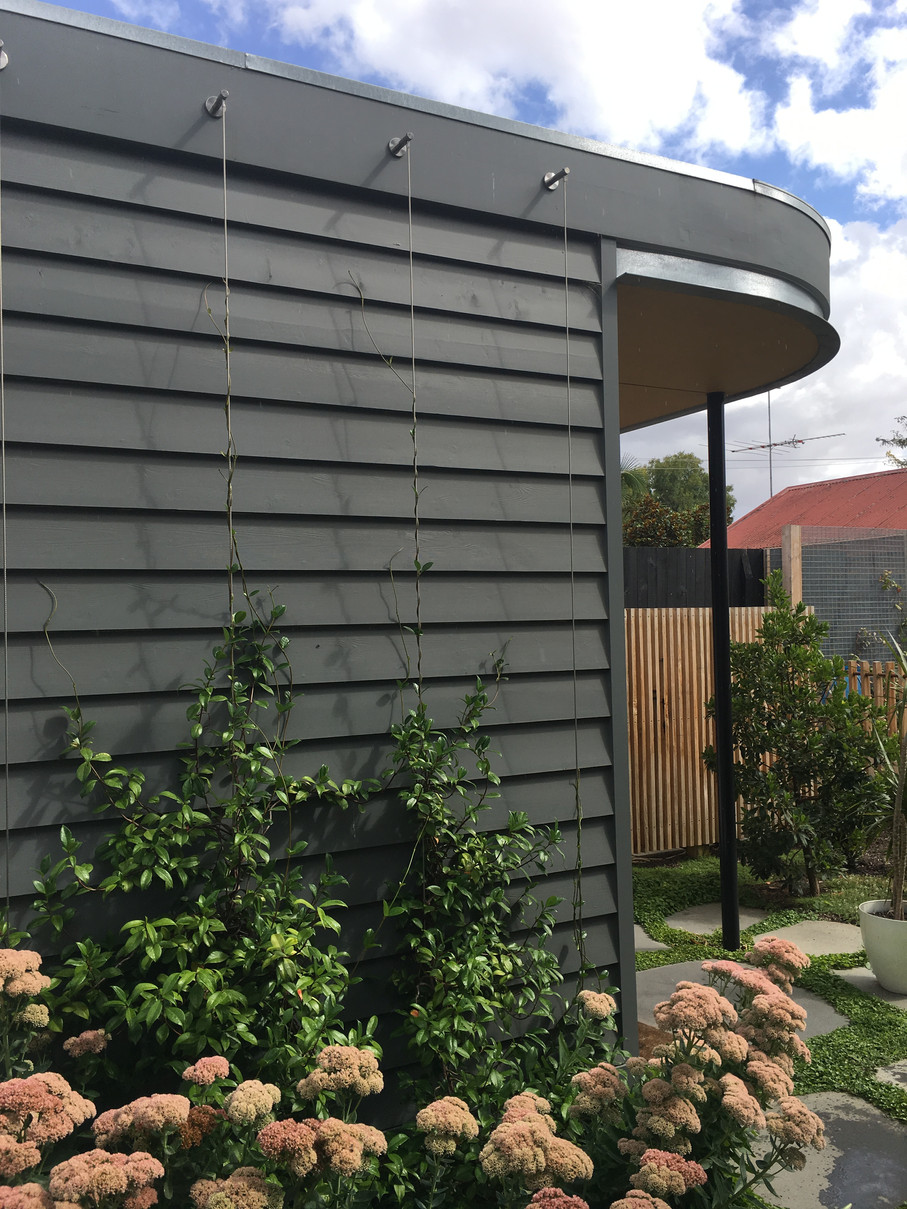 The vertical garden wall softens the exterior