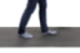 A person from the knees and below walking across the Walkway Sensor in socks.