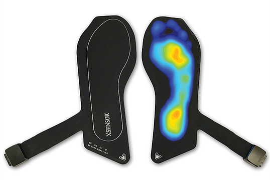 Two XSENSOR X4 Foot & Gait Measurement Insoles with the right insole showing the high-resolution pressure data possible with the system.
