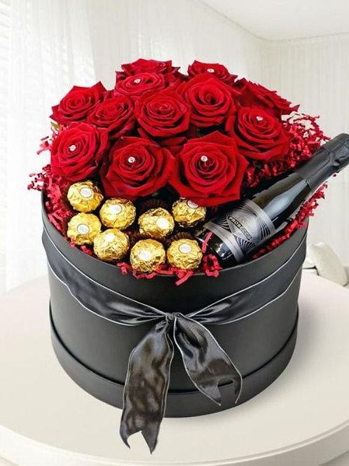 caja de rosas con botella de vino