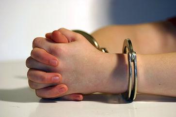 kid-in-cuffs.jpg