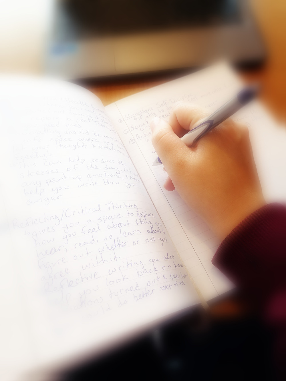 A picture of me writing in my journal.