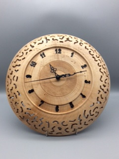 Wall Clock Wood: Sycamore (pierced) Size: 12 X 2 Price: £75 (ref.5334)