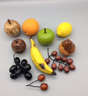 Various Pieces of Fruit:  Grapes: £15 a bunch Bananas: £10 each Apples: £10 each Pears: £10 each Oranges: £10 each Lemons: £10 each Cherries: £5 a pair  (woods may differ from image)