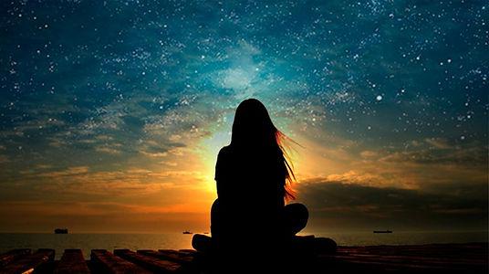 Guided-Meditation-Lady-Sitting-on-Beach-