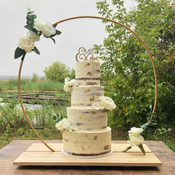 4 semi naked tiers with gold leaf and fl