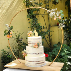 Semi naked, three tiered wedding cake wi