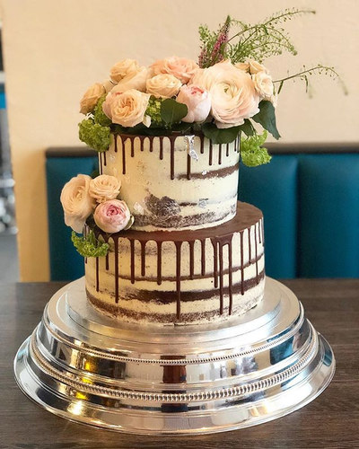 Seminaked chocolate drip wedding cake wi