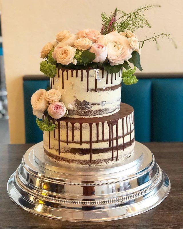 Seminaked chocolate drip wedding cake wi