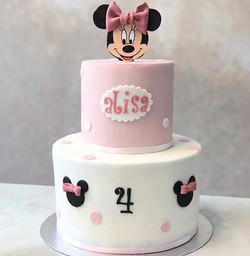 A cute minnie mouse cake for alisa's 4th