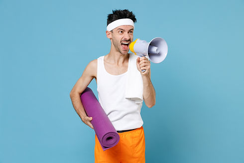 Angry young strong sporty fitness man with skinny body sportsman in white headband shirt shorts hold
